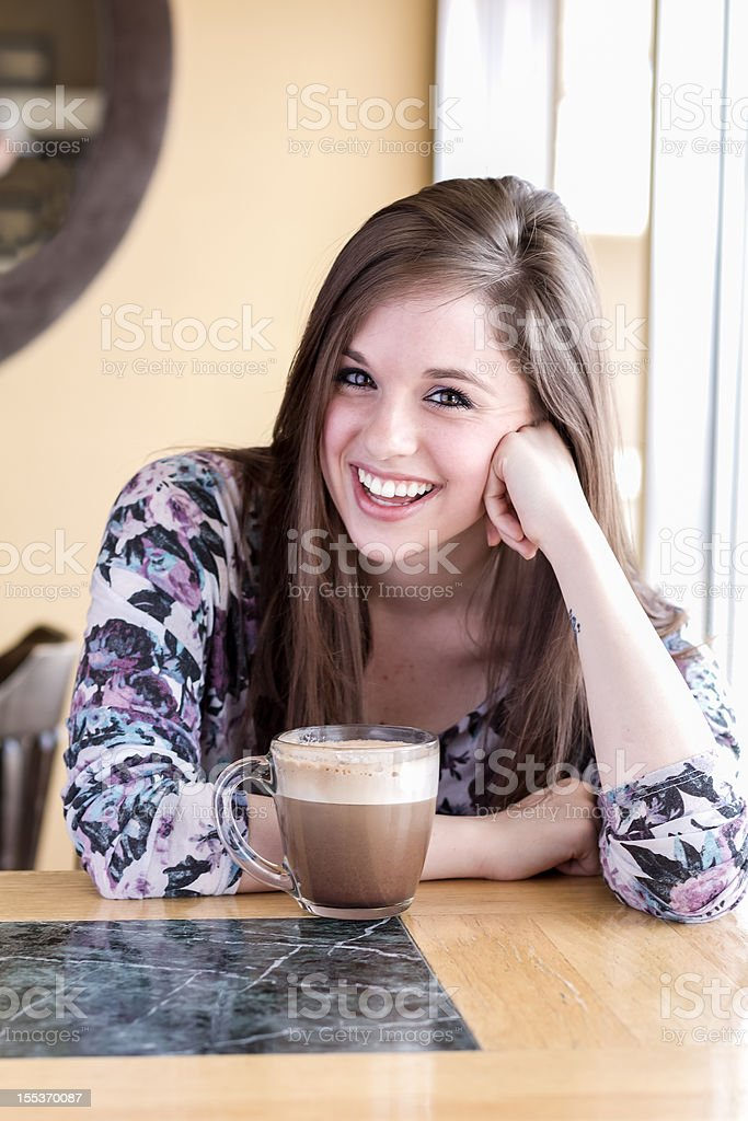 Beautiful Girl Drinking Latte royalty-free stock photo