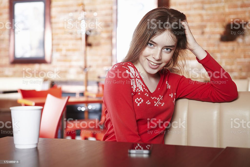 Beautiful girl drinking tea in cafe royalty-free stock photo