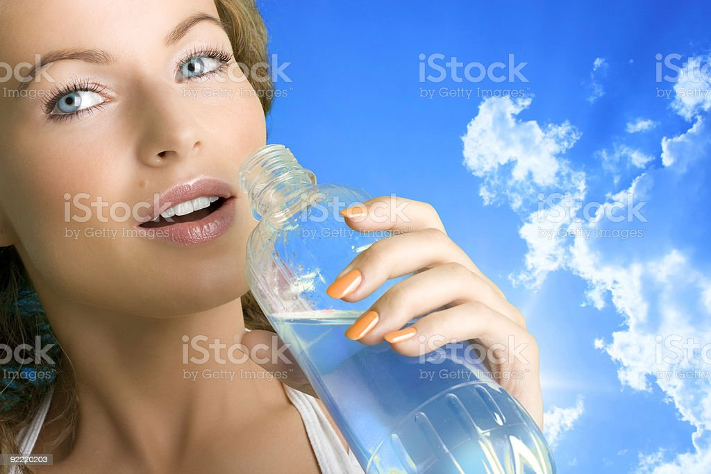 Beautiful girl drinking water royalty-free stock photo