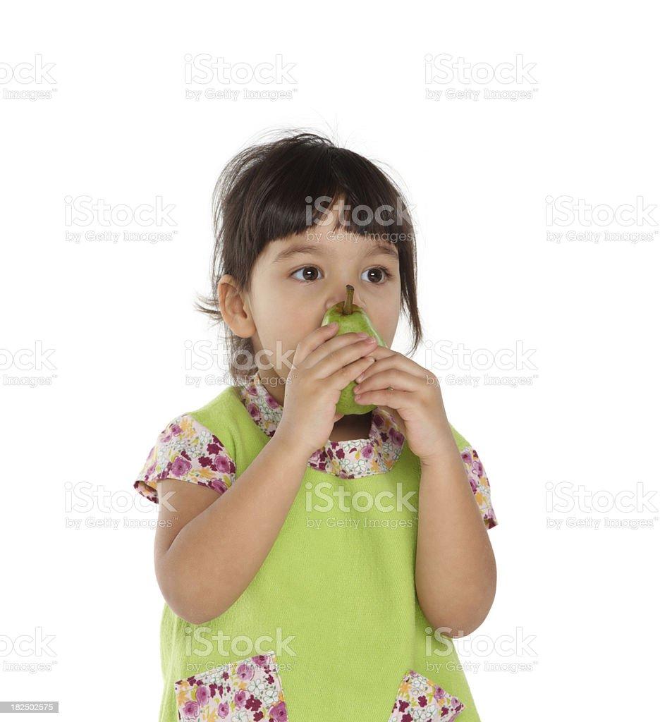 beautiful girl eating a pear fruit stock photo