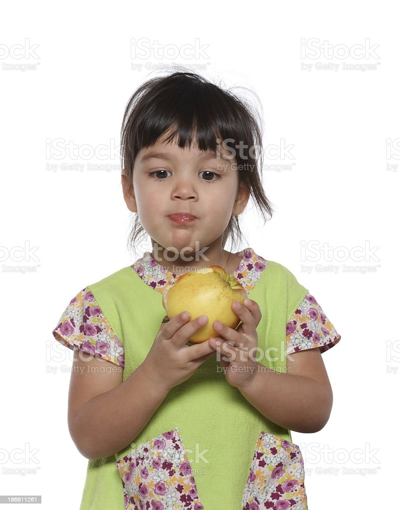 beautiful girl eating an apple stock photo