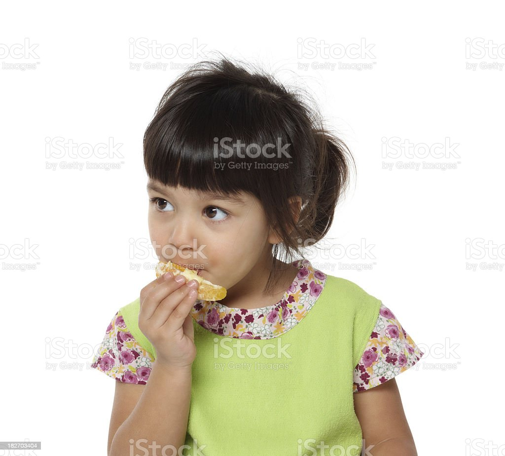 beautiful girl eating an orange stock photo