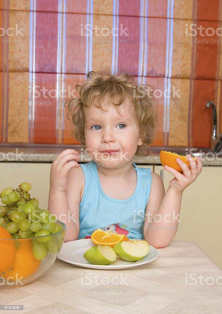 Beautiful girl eats fruit royalty-free stock photo