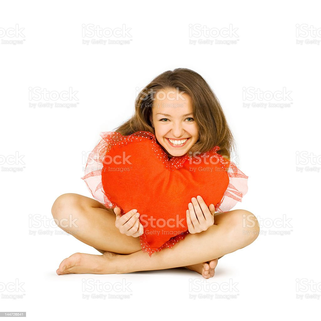 beautiful girl embraces red heart royalty-free stock photo