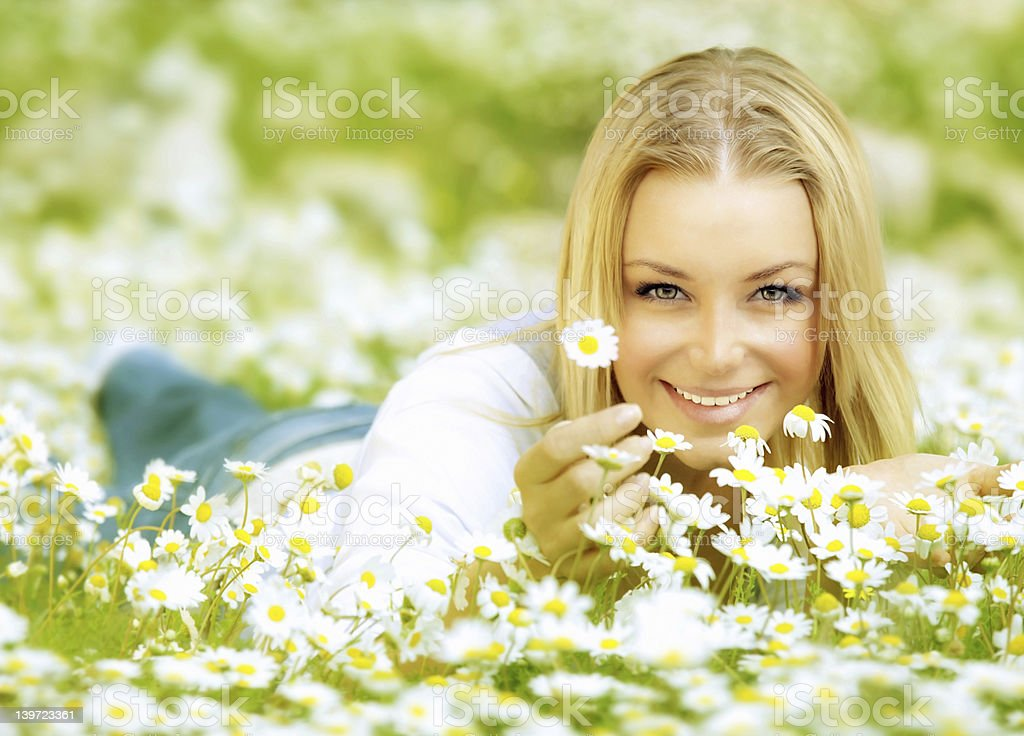 Beautiful girl enjoying daisy field royalty-free stock photo