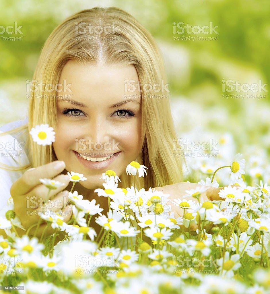Beautiful girl enjoying daisy field royalty-free stock photo