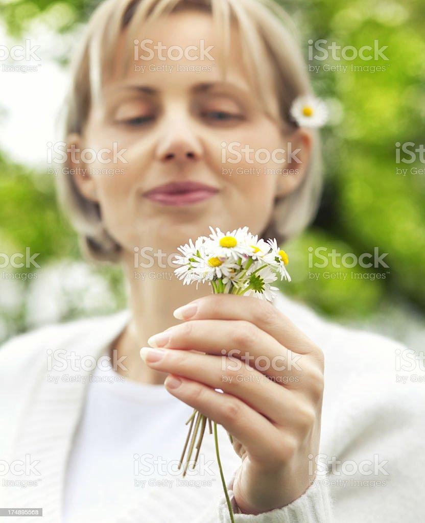 Beautiful girl enjoying daisy flower royalty-free stock photo