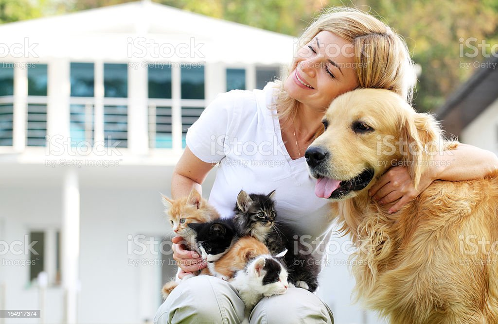 Beautiful girl enjoying outdoor with pets. stock photo