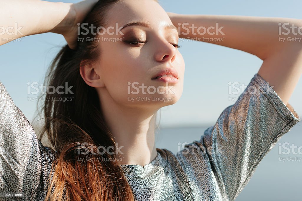 Beautiful girl enjoying the sun and the warmth stock photo