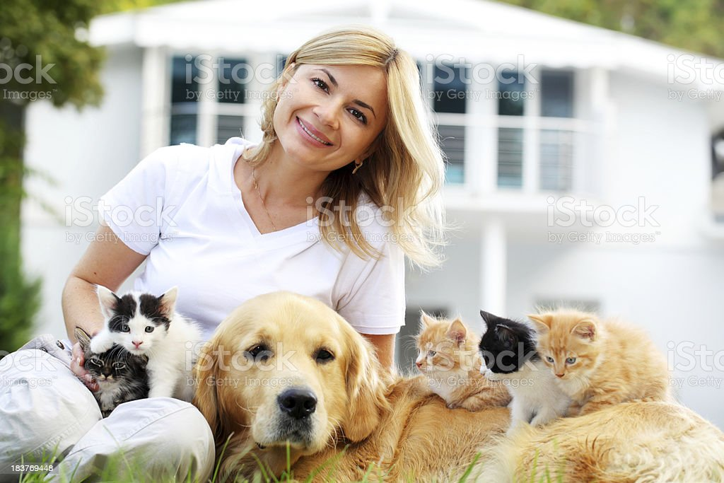 Beautiful girl enjoys outdoor with pets. royalty-free stock photo