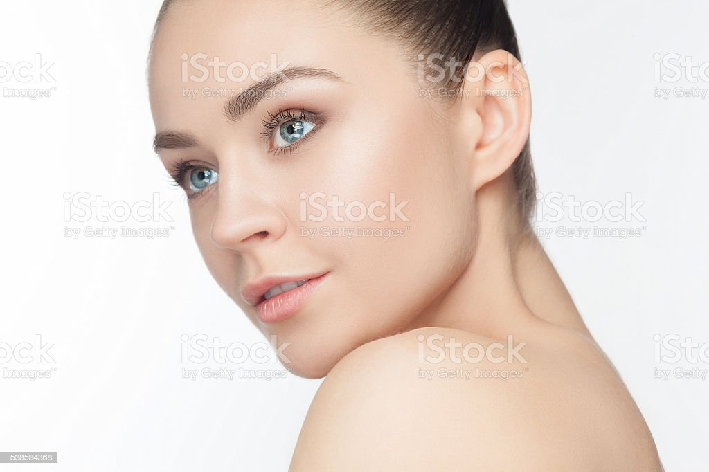 Beautiful Girl face. Perfect skin stock photo
