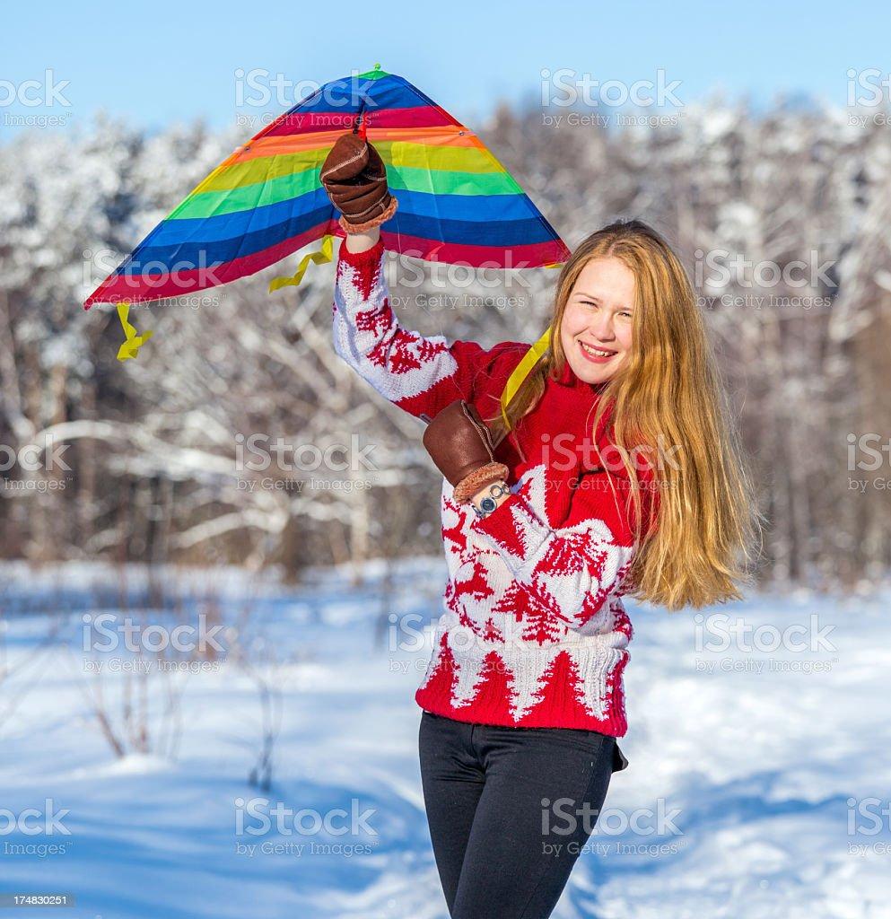 Beautiful girl flying her kite royalty-free stock photo