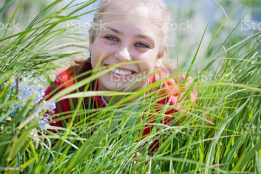 Beautiful girl gathering flowers royalty-free stock photo