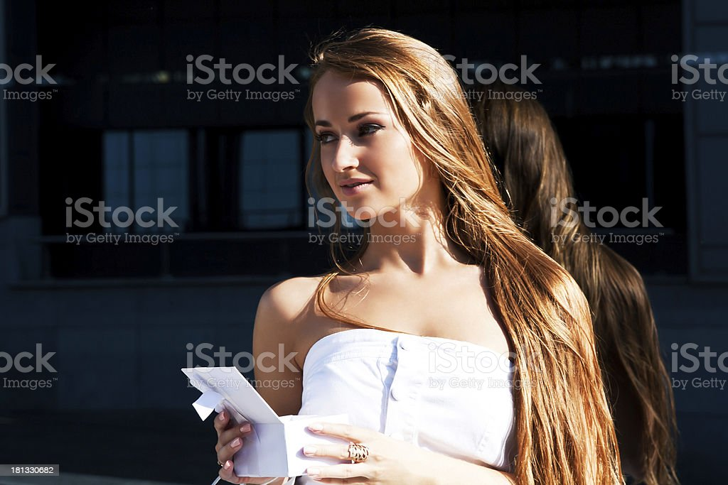 Beautiful girl has received gift stock photo