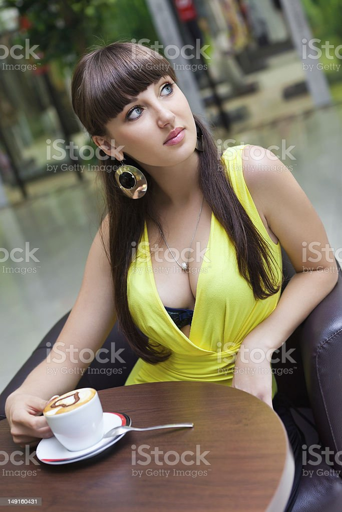Beautiful girl having coffee at cafe royalty-free stock photo