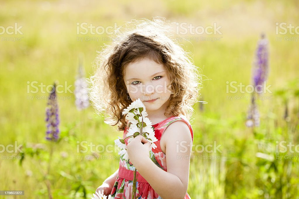 Beautiful girl holding a bunch of flowers. royalty-free stock photo