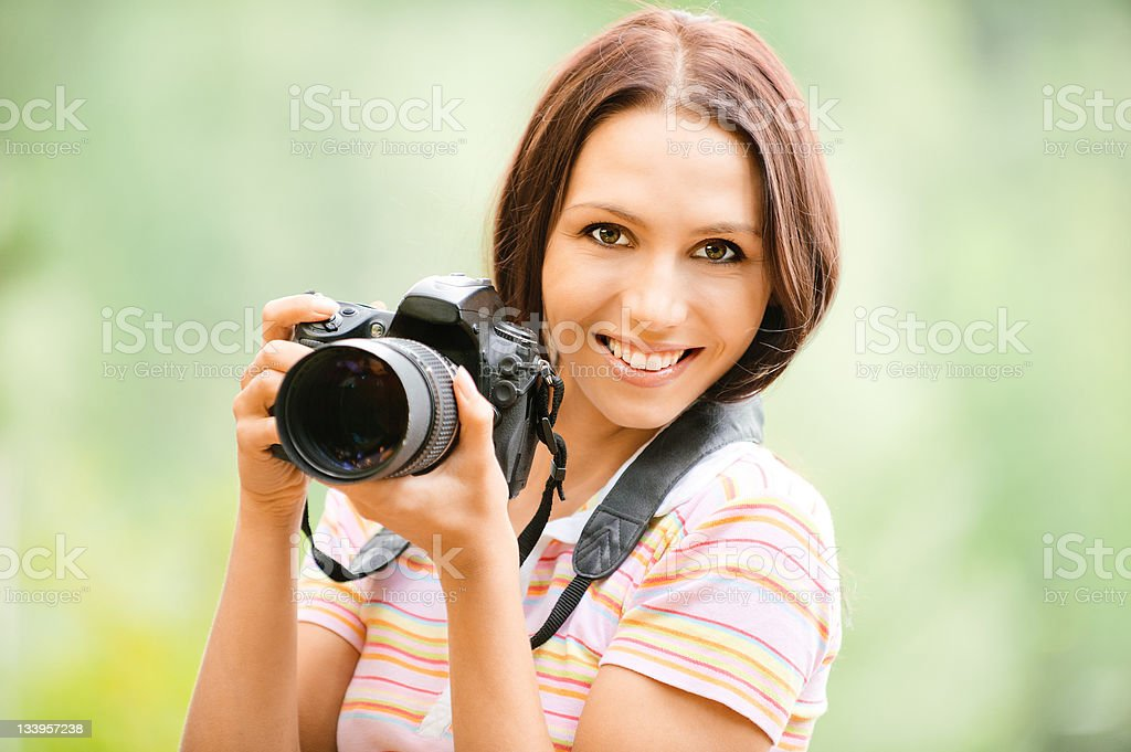 A beautiful girl holding a camera  royalty-free stock photo