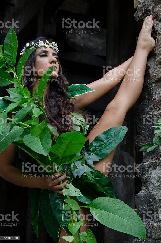 Beautiful girl holding a snake stock photo