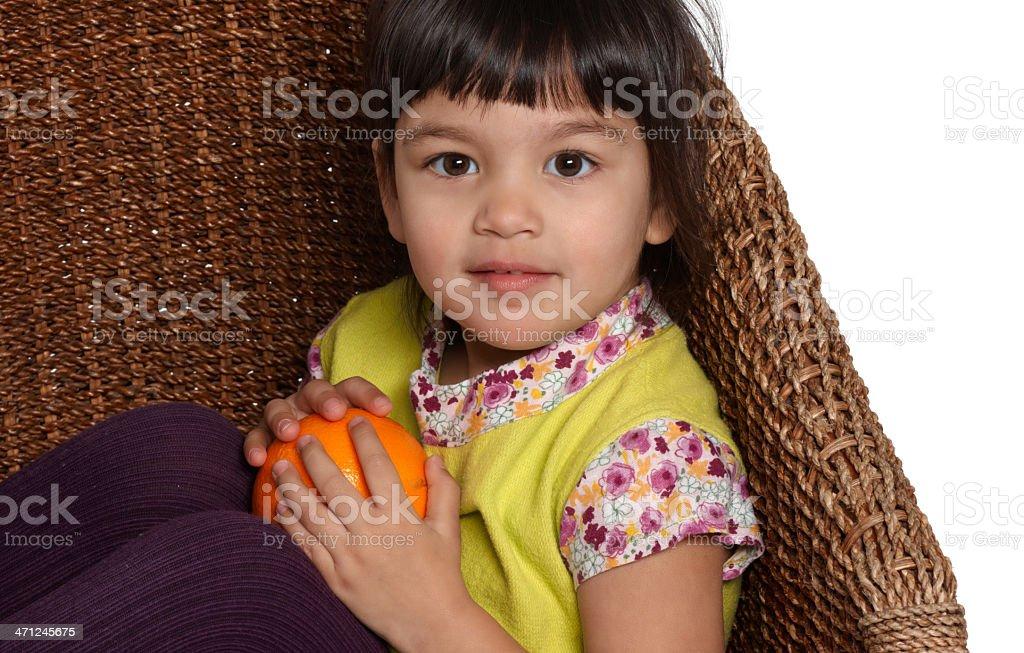 beautiful girl holding an orange stock photo