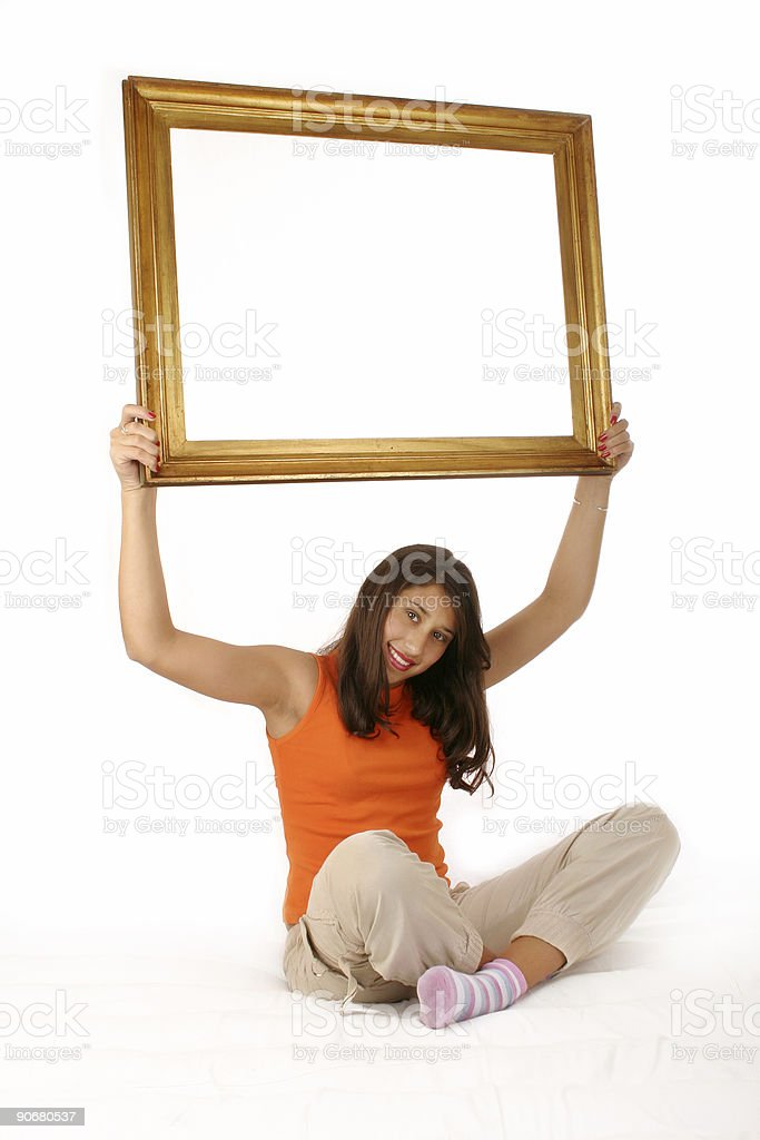 Beautiful girl holding blank frame royalty-free stock photo