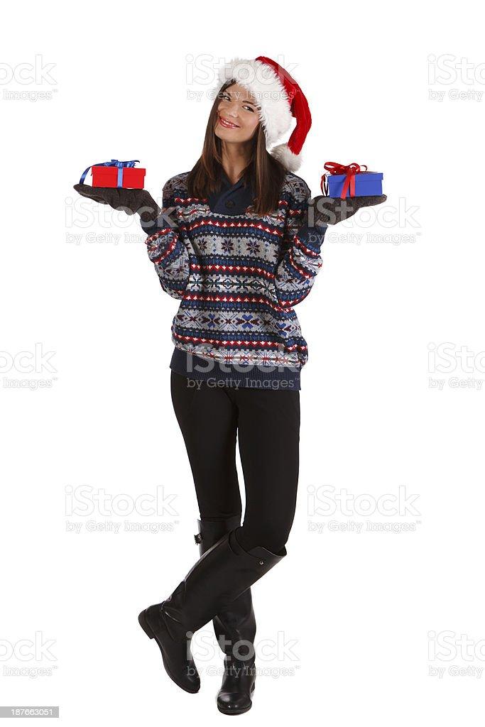 Beautiful girl holding christmas gifts stock photo