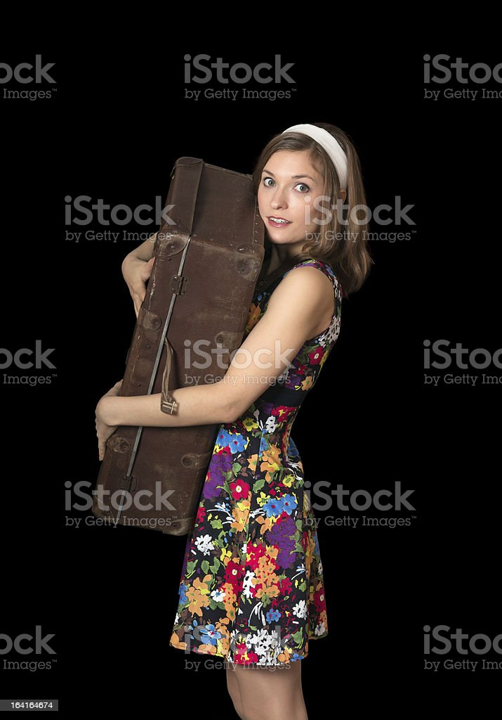 Beautiful girl holding old suitcase royalty-free stock photo