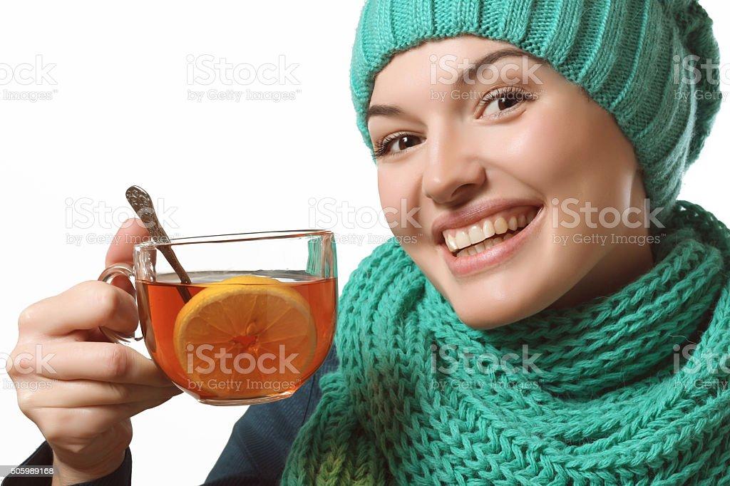 beautiful girl holding tea with lemon, recovery stock photo
