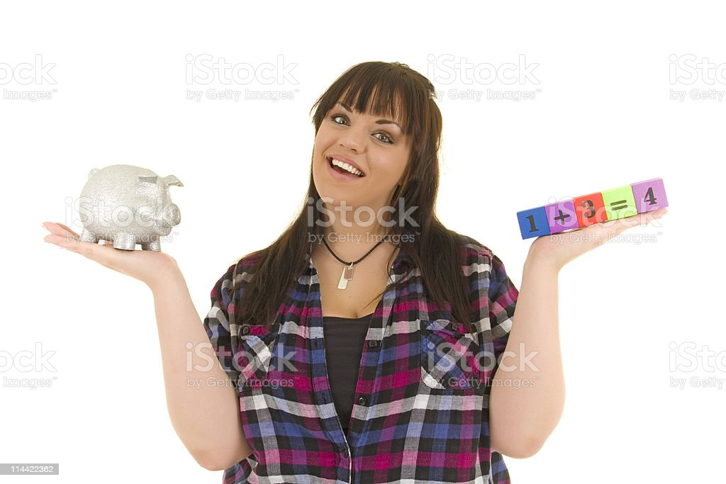 Beautiful girl holds piggy bank and equation stock photo