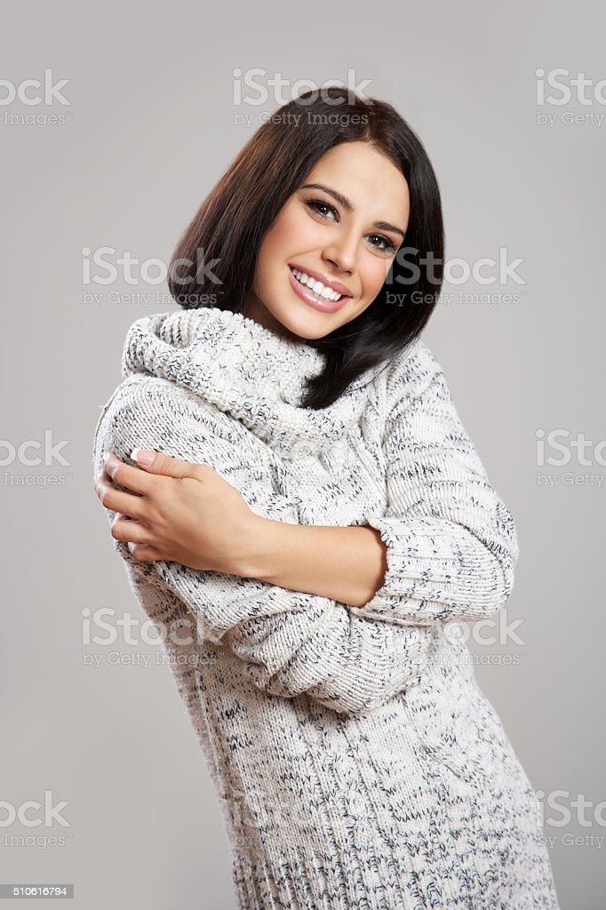 beautiful girl in a Christmas cap with tangerines in hands stock photo