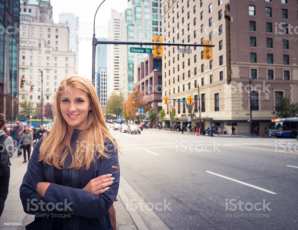 Beautiful girl in a city stock photo