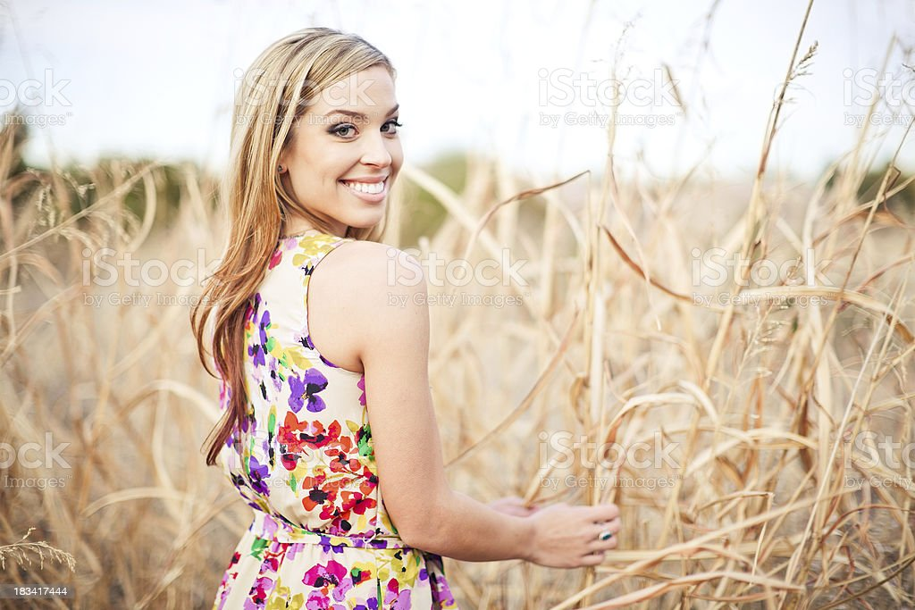 Beautiful girl in a field. royalty-free stock photo