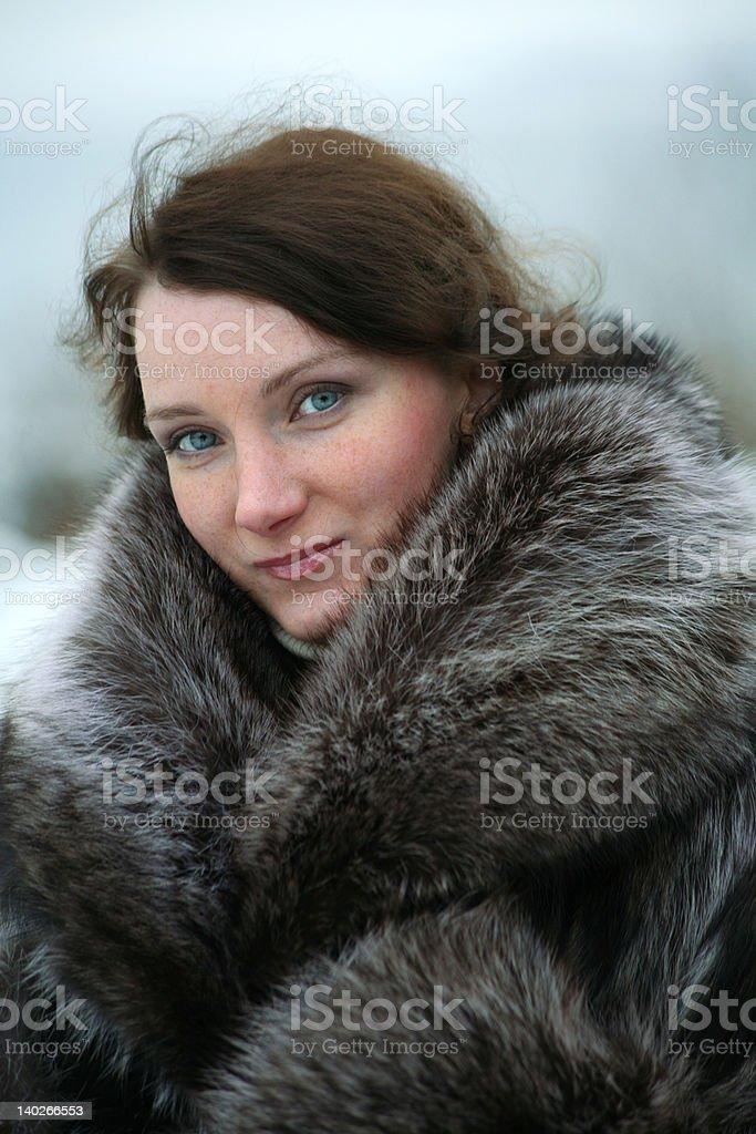 beautiful girl in a fur coat royalty-free stock photo