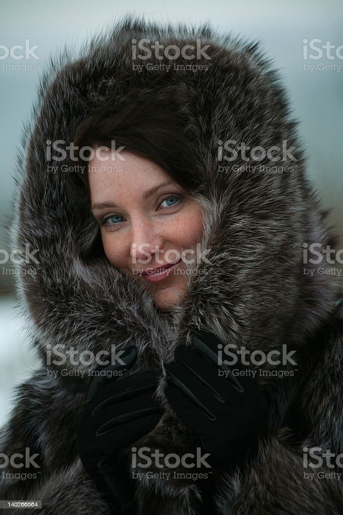 beautiful girl in a fur coat royalty-free stock photo
