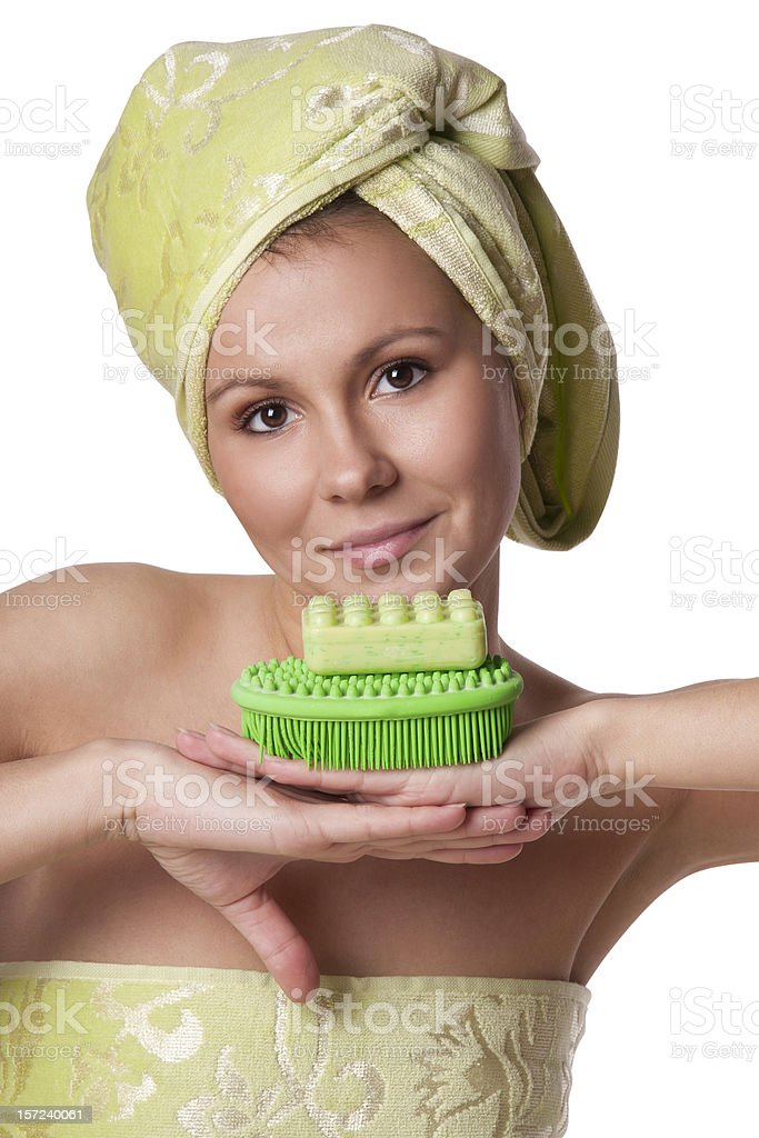 Beautiful girl in a green towel keeps bath royalty-free stock photo