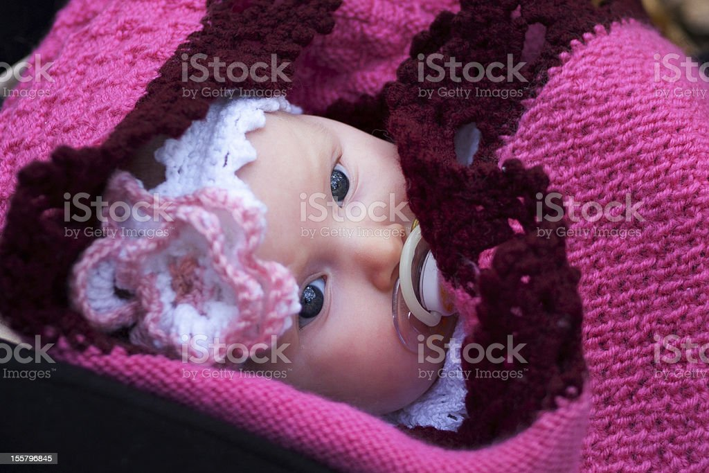 Beautiful girl in a pink baby clothes royalty-free stock photo