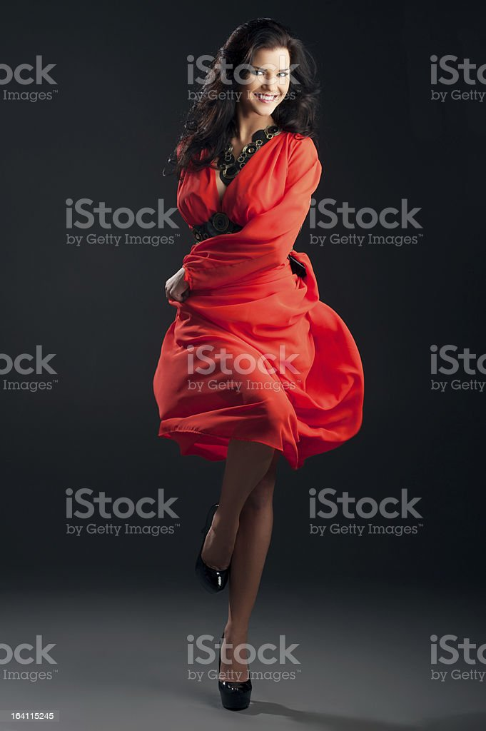 beautiful girl in a red dress royalty-free stock photo