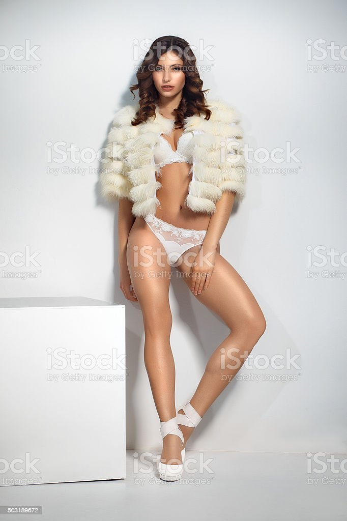 beautiful girl in a short fur coat and underwear stock photo