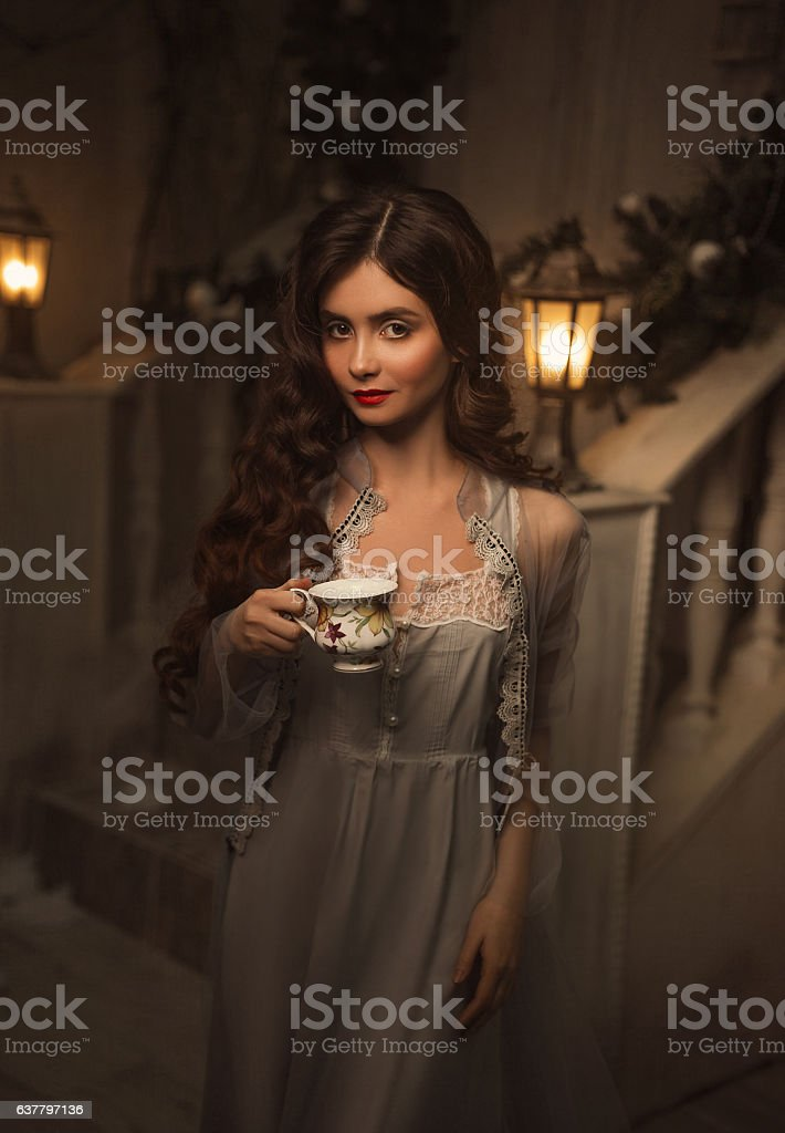 Beautiful girl in a vintage dress stock photo