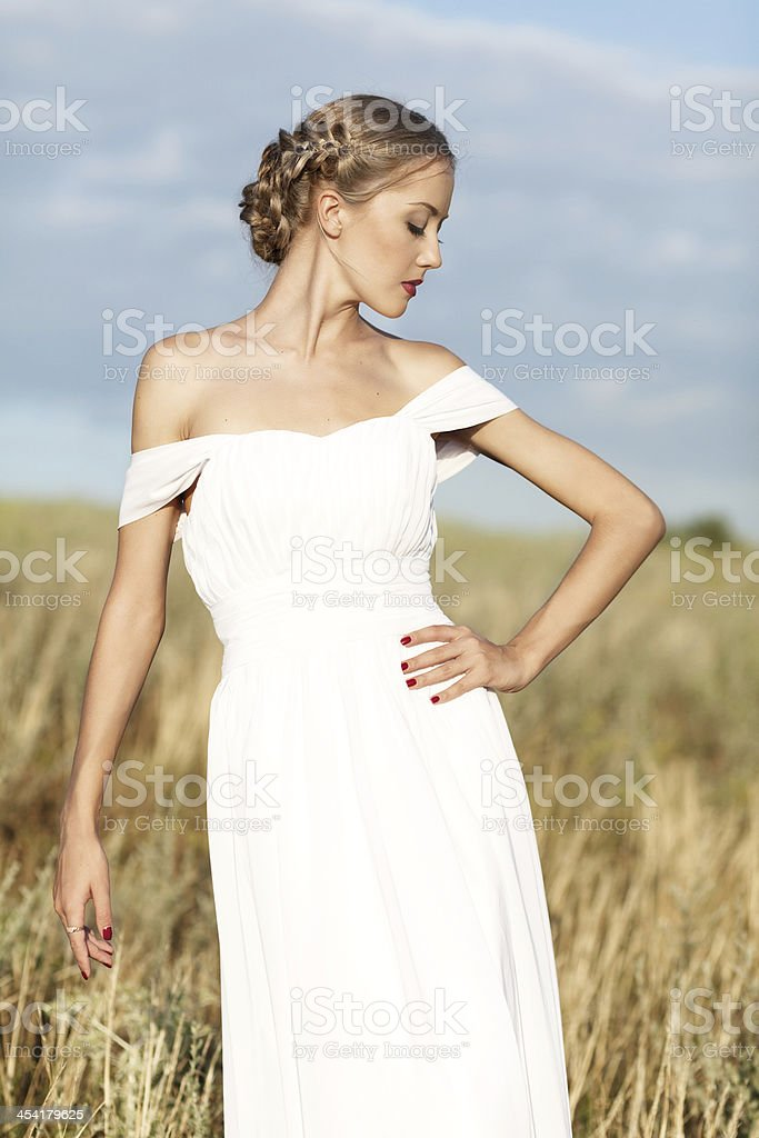 beautiful girl  in a white dress stock photo