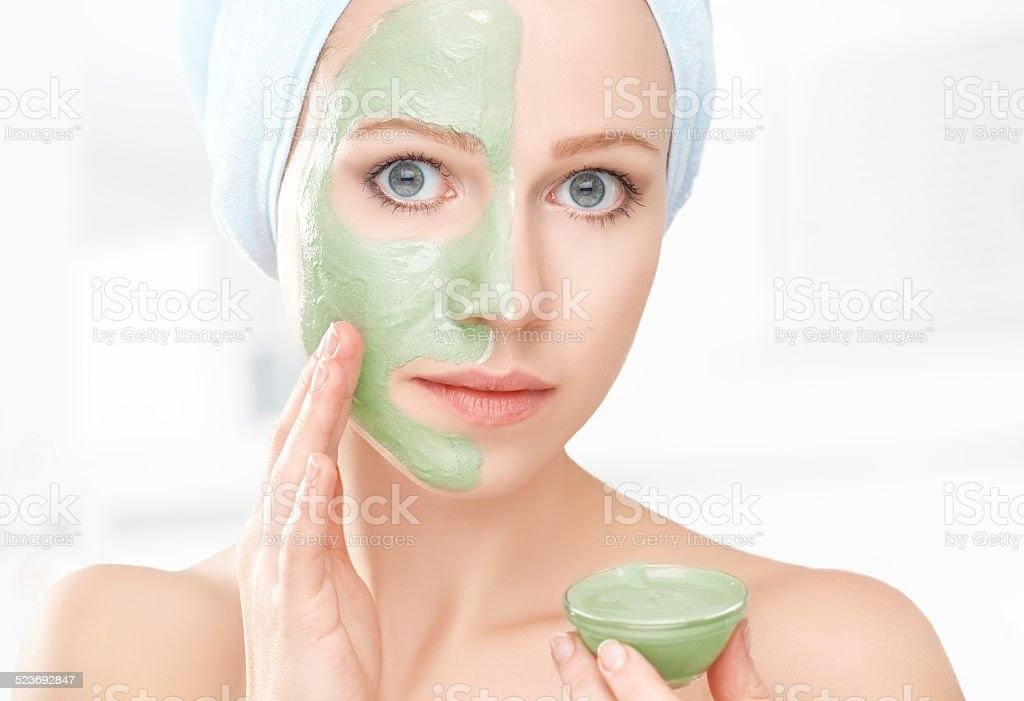 beautiful girl in bathroom and mask for facial skin care stock photo