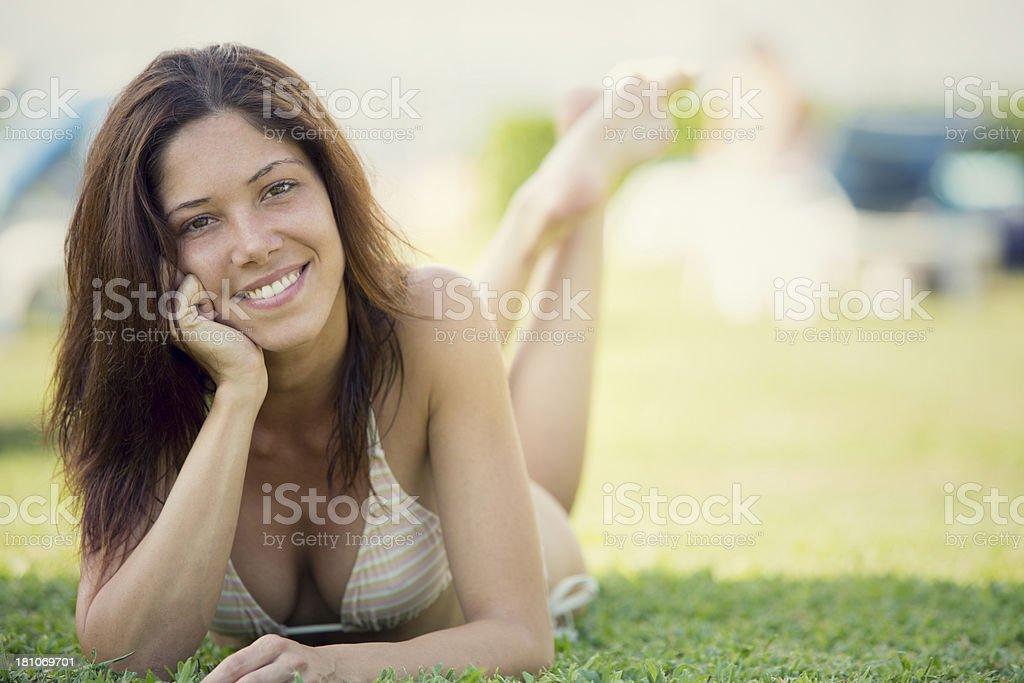 Beautiful girl in bikini at swimming pool outdoor stock photo