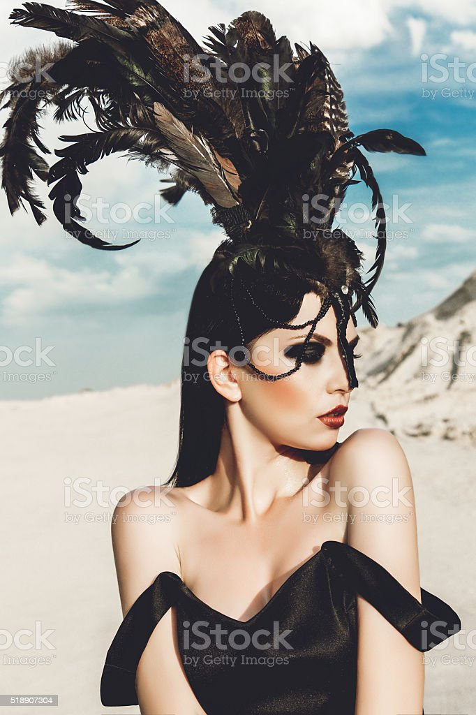 beautiful girl in black dress and hat with feathers stock photo