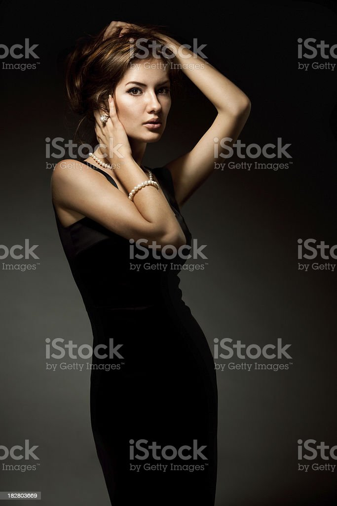 Beautiful girl in black dress on dark background royalty-free stock photo