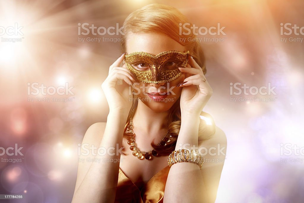 Beautiful girl in carnival mask stock photo