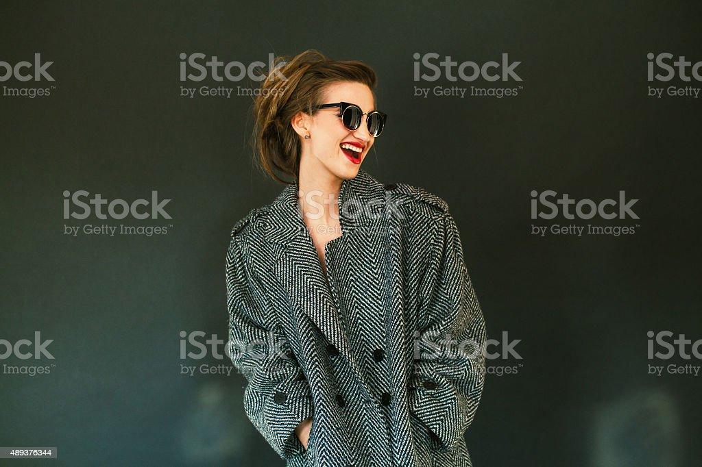 beautiful girl in coat stock photo