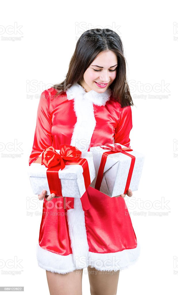beautiful girl in dress holding Christmas gifts stock photo