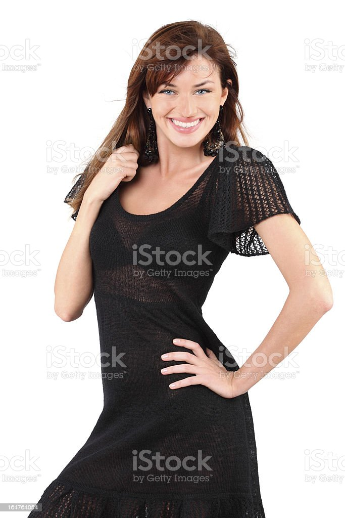 Beautiful girl in dress smiles and holds her hair royalty-free stock photo