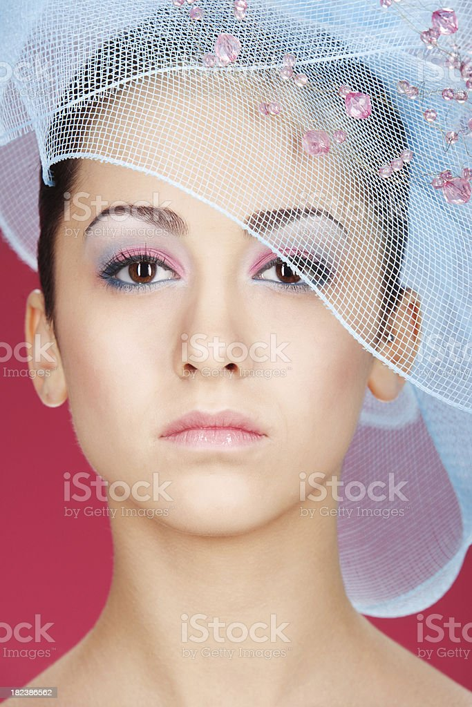 Beautiful girl in fashionable hat on red background royalty-free stock photo