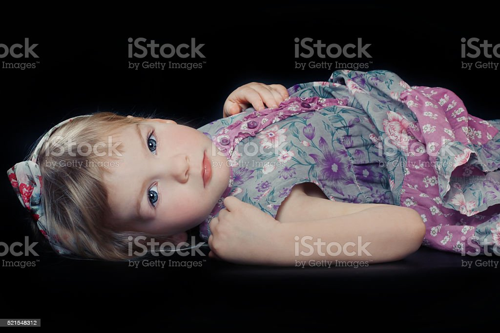 Beautiful girl in floral dress stock photo