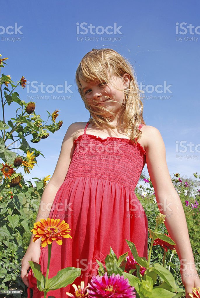 Beautiful girl in flower garden royalty-free stock photo
